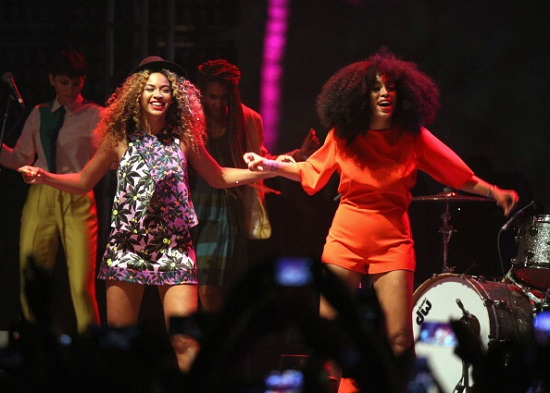 INDIO, CA - APRIL 12:  Singers Solange (R) and Beyonce perform onstage during day 2 of the 2014 Coachella Valley Music & Arts Festival at the Empire Polo Club on April 12, 2014 in Indio, California.  (Photo by Imeh Akpanudosen/Getty Images for Coachella)
