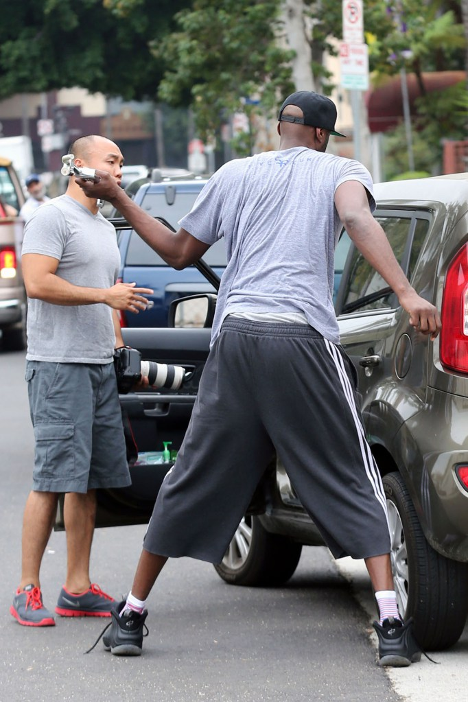 Lamar Odom hits a photographers car with a piece of metal and takes camera gear from another photographers car